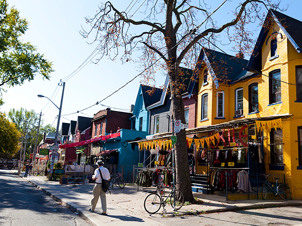 Kensington Market is a distinctive multicultural neighbourhood in Downtown Toronto, Ontario, Canada. The Market is an older neighbourhood and one of the city's most well-known. In November 2006, it was designated a National Historic Site of Canada Its approximate borders are College St. on the north, Spadina Ave. on the east, Dundas St. W. to the south, and Bellevue Ave. to the west. Most of the neighbourhood's eclectic shops, cafes, and other attractions are located along Augusta Ave. and neighbouring Nassau St., Baldwin St., and Kensington Ave.