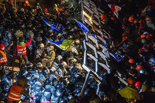Riot police storms barricade of protesters