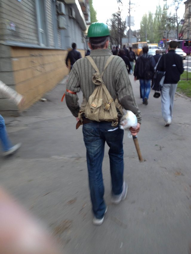 Donetsk, April 29, 2014. Russian bandit after beating participants of assembly