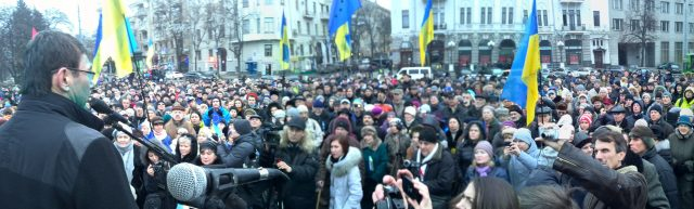 December 28, 2013, Kharkiv, Lutsenko speaks to the crowd after having been splattered with brilliant green (an act intended as public humiliation, similar to tarring and feathering). Photo by Nataliya Zubar