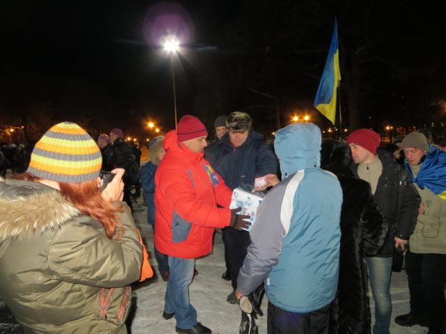 Kharkiv, December 11, 2013, a member of coordinating council of Euromaidan Kharkiv collects donations at the assembly